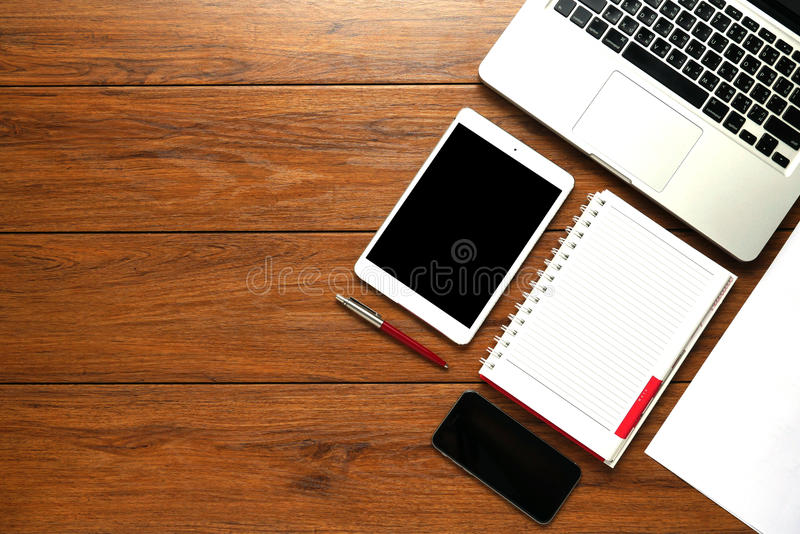 Flat lay, Close up Clean Open Notebook. Phone, paper, Tablet, on Top of Wooden Table with Copy Space Below for Texts royalty free stock photos