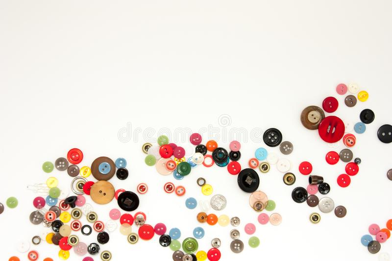 Flat lay with colorful sewing buttons, mock up, top view. Layout buttons mockup on blank white background for needlework, sewing, stock photo