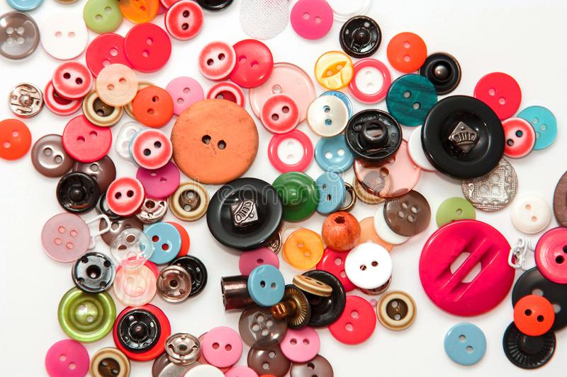 Flat lay with colorful sewing buttons, mock up, top view. Layout buttons mockup on blank white background for needlework, sewing, stock images