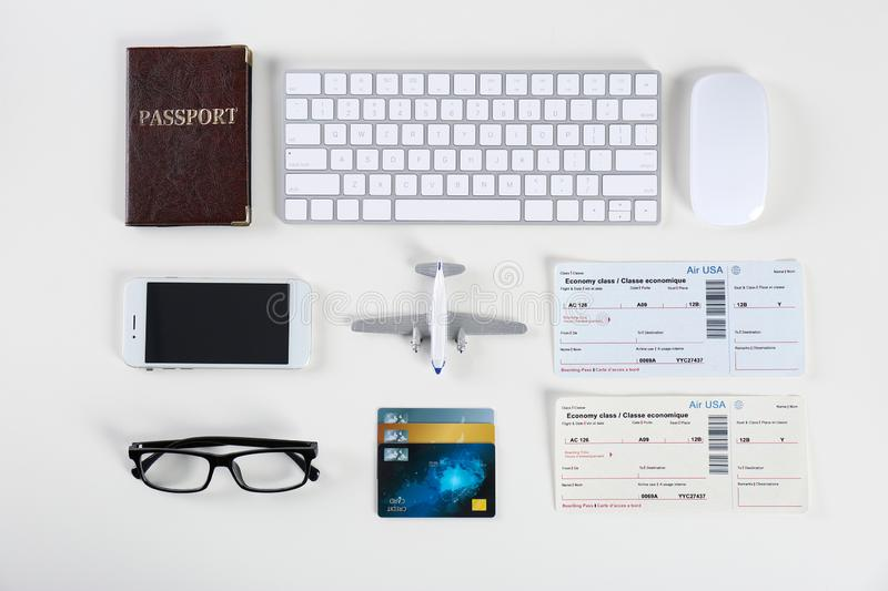 Flat lay composition with airplane and computer keyboard on light background royalty free stock photos