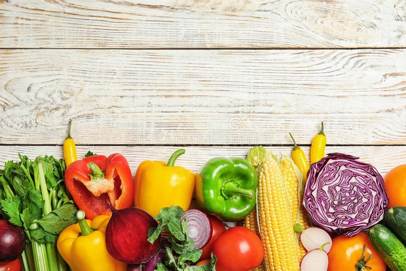 Flat lay composition with assortment of fresh vegetables on wooden background stock image