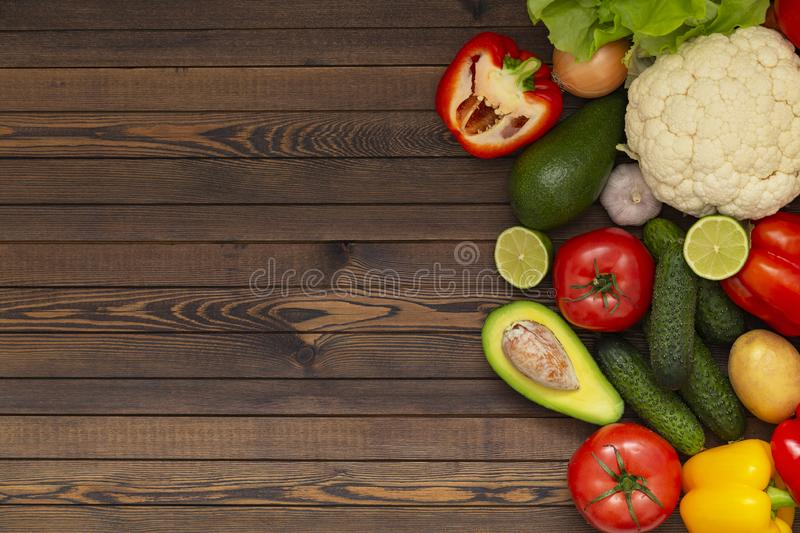 Flat lay composition with assortment of fresh vegetables on wooden table. Fresh farmers garden vegetables on wooden table. stock images