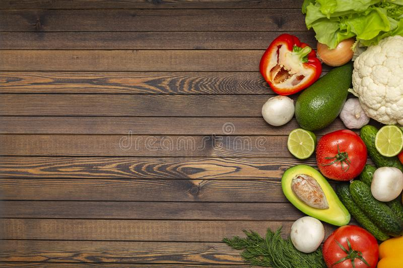 Flat lay composition with assortment of fresh vegetables on wooden table. Fresh farmers garden vegetables on wooden table. royalty free stock photos