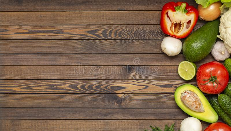 Flat lay composition with assortment of fresh vegetables on wooden table. Fresh farmers garden vegetables on wooden table. stock photo