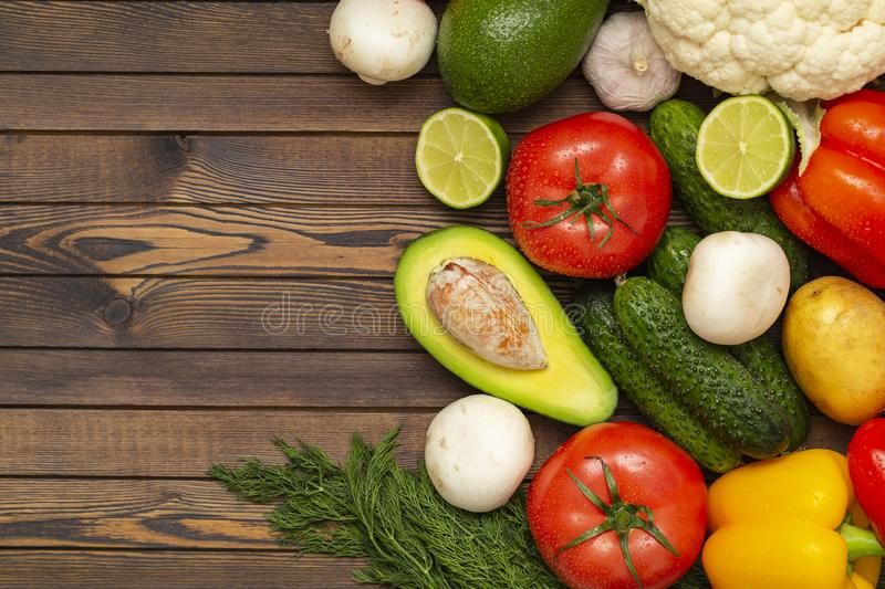 Flat lay composition with assortment of fresh vegetables on wooden table. Fresh farmers garden vegetables on wooden table. royalty free stock photography