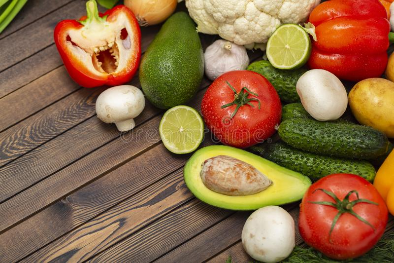 Flat lay composition with assortment of fresh vegetables on wooden table. Fresh farmers garden vegetables on wooden table. stock photos