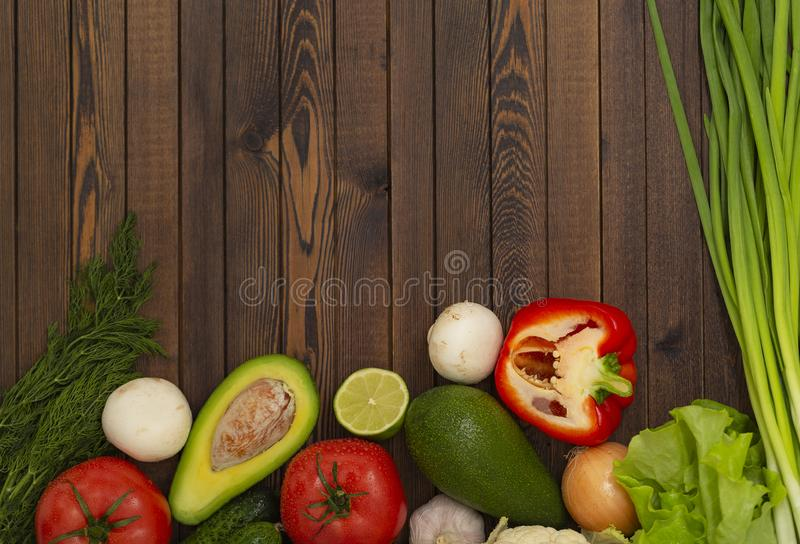 Flat lay composition with assortment of fresh vegetables on wooden table. Fresh farmers garden vegetables on wooden table. royalty free stock images
