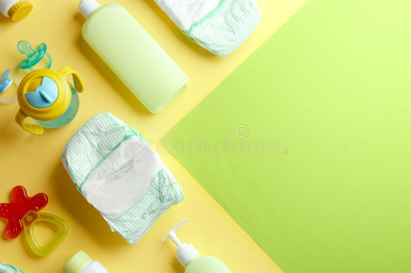 Flat lay composition with baby accessories on color background. Flat lay composition with baby accessories and space for text on color background stock photo