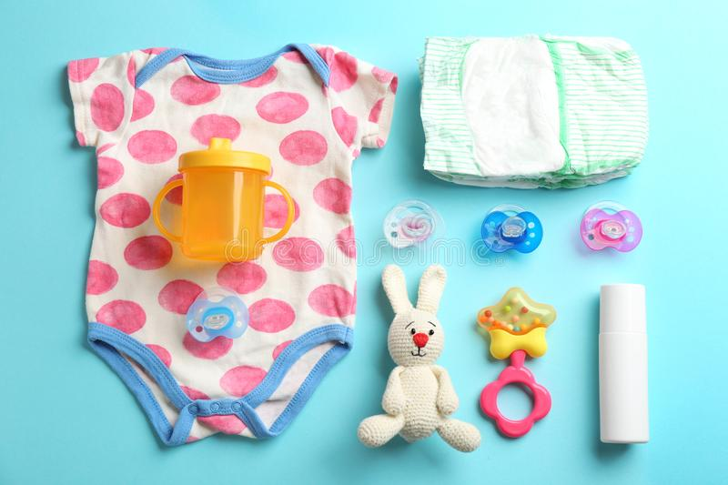 Flat lay composition with baby accessories. On color background royalty free stock images