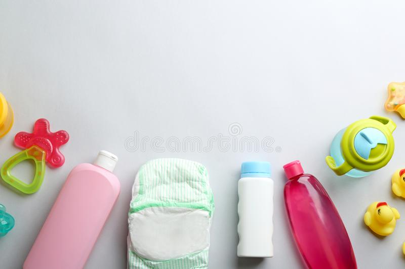 Flat lay composition with baby accessories on light background. Flat lay composition with baby accessories and space for text on light background royalty free stock image