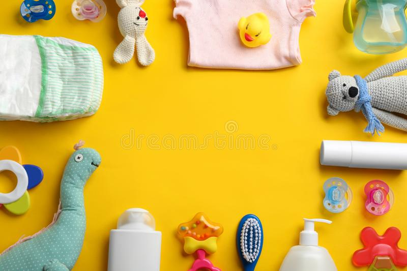 Flat lay composition with baby accessories and space for text. On color background stock image