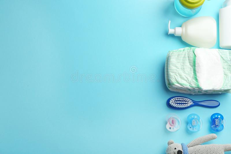 Flat lay composition with baby accessories and space for text. On color background stock photos