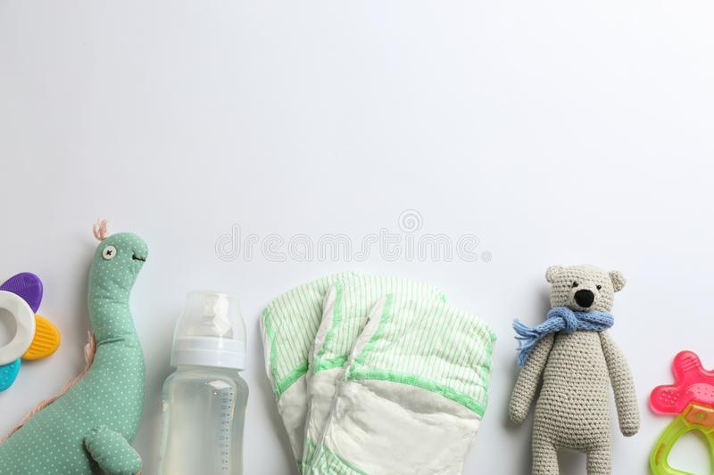 Flat lay composition with baby accessories and space for text on white. Background stock images