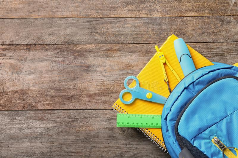 Flat lay composition with backpack, school stationery royalty free stock photography