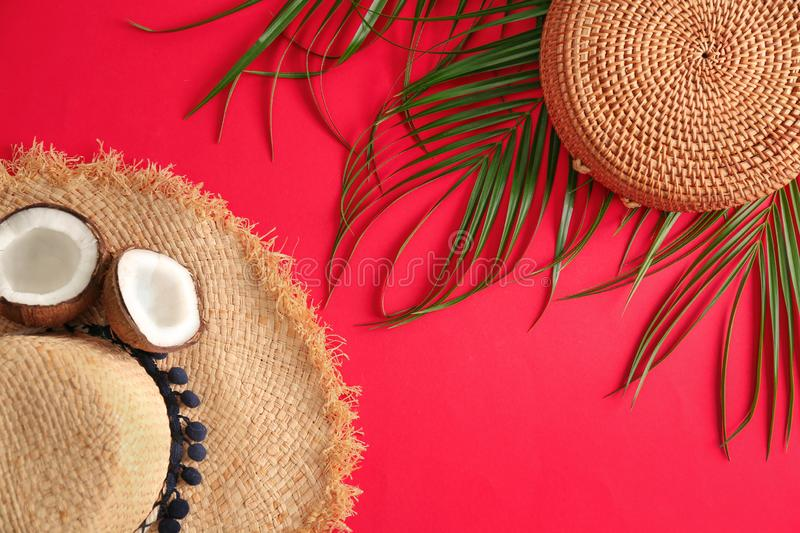 Flat lay composition with bamboo bag and straw hat. On color background royalty free stock photo