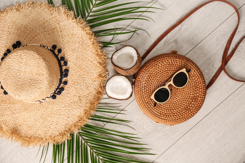 Flat lay composition with bamboo bag and straw hat. On wooden background stock images