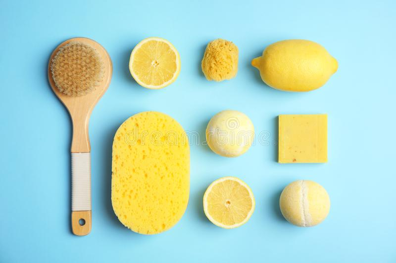 Flat lay composition with bath bombs, toiletries and lemons. On color background royalty free stock photo