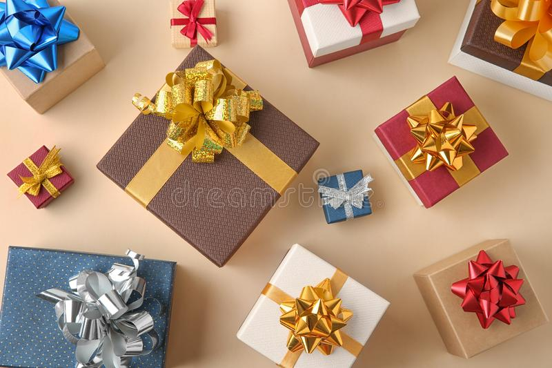 Flat lay composition with gift boxes on beige background. Flat lay composition with beautiful gift boxes on beige background stock photography