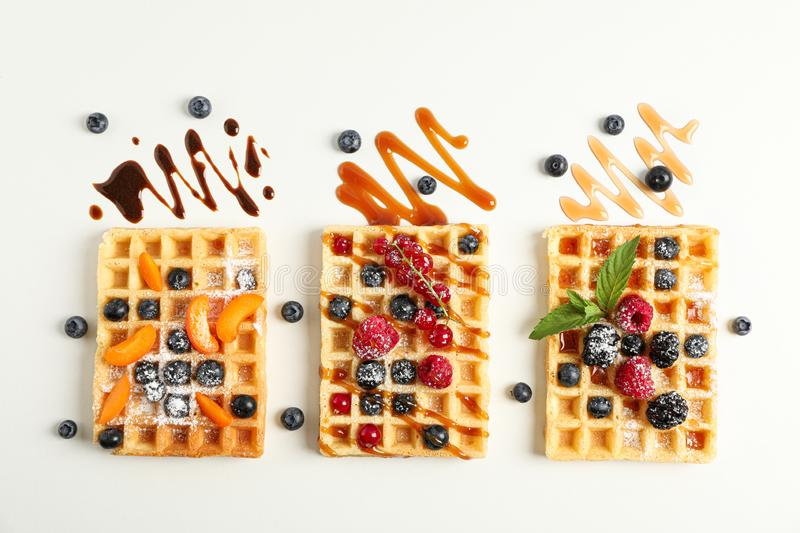 Flat lay composition with belgian waffles and different toppings royalty free stock photo