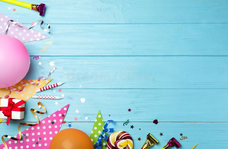 Flat lay composition with birthday party items on blue wooden background stock images