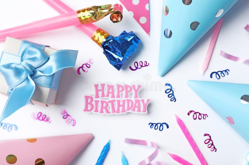 Beautiful flat lay composition with birthday party items on light background royalty free stock photography