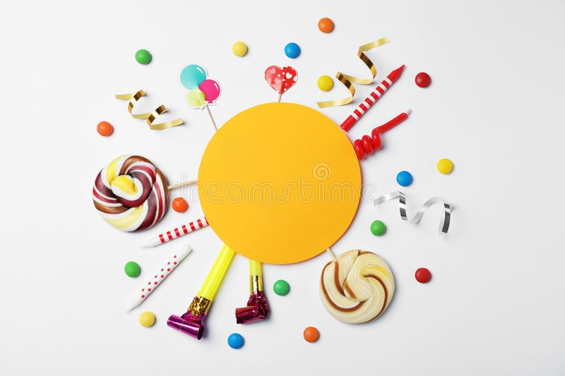 Flat lay composition with birthday party items. On light background royalty free stock image