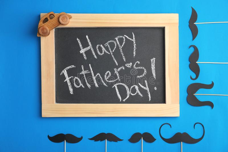 Flat lay composition with blackboard and moustaches. On color background. Happy Father`s Day stock photos