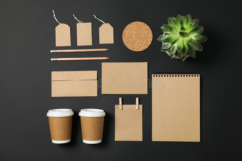 Flat lay composition with blank stationery and succulent on black background. Copy space stock images
