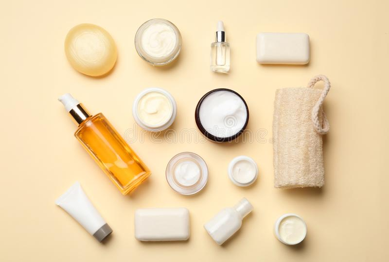 Flat lay composition with body care products. On color background royalty free stock photography