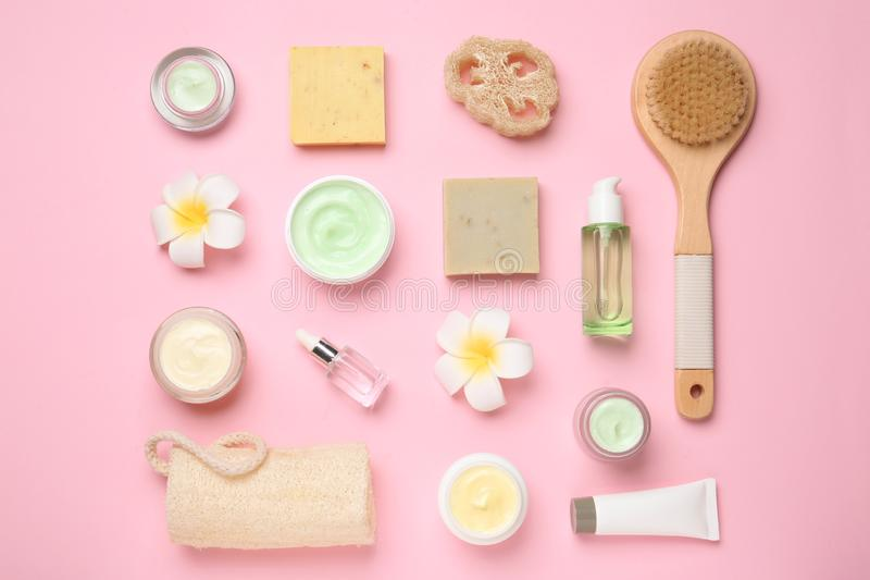 Flat lay composition with body care products. On color background stock images