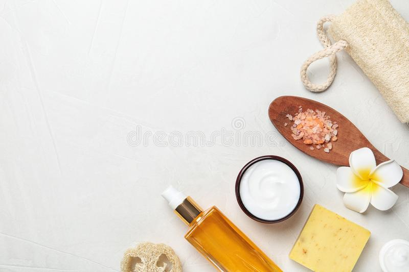 Flat lay composition with body care products. And space for text on light background royalty free stock photos
