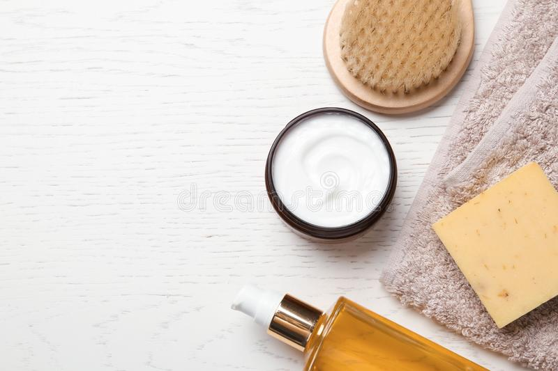 Flat lay composition with body care products. And space for text on white wooden background stock photos