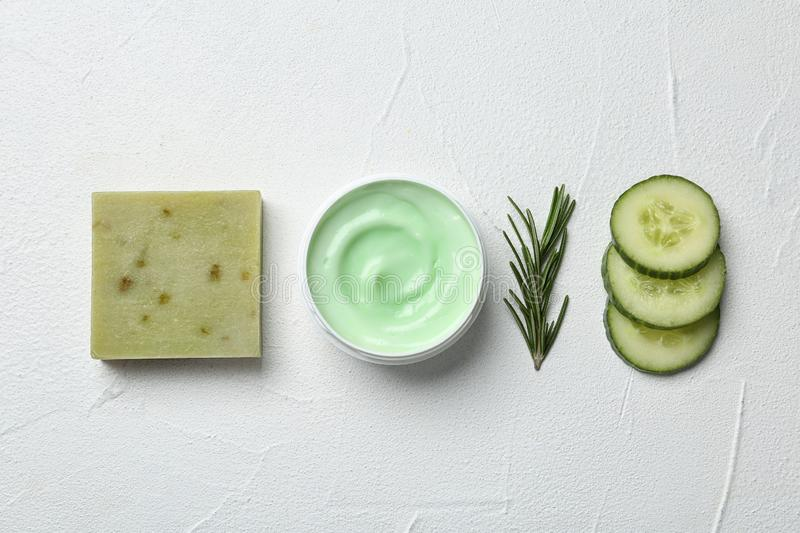 Flat lay composition with body care products and ingredients on white. Background royalty free stock photography