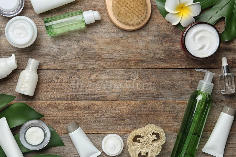 Flat lay composition with body care products and space for text. On wooden background stock photo