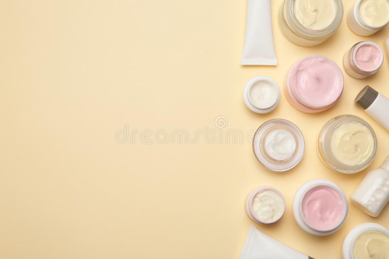 Flat lay composition with body care products and space for text. On color background royalty free stock images