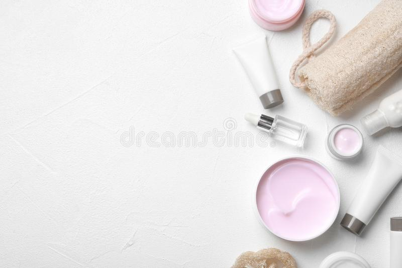 Flat lay composition with body care products and space for text. On white background stock images