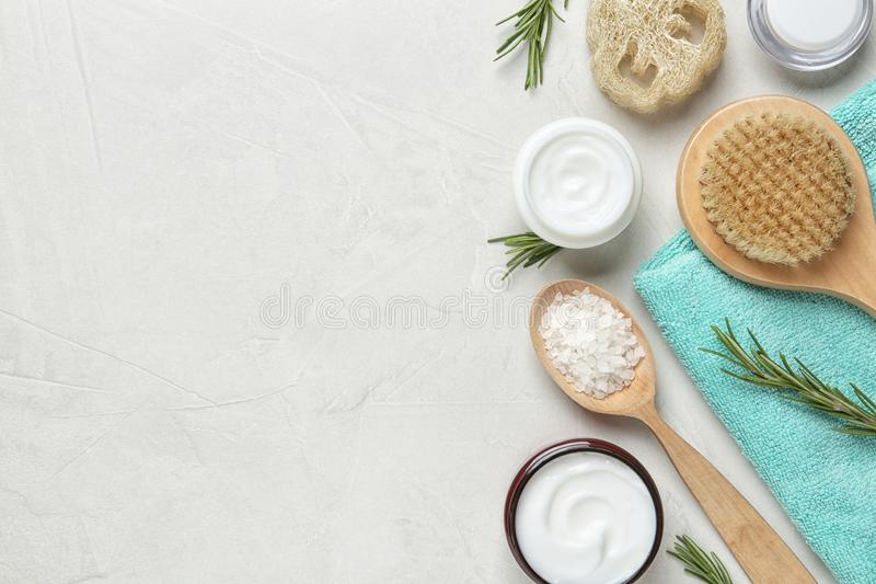 Flat lay composition with body care products and space for text. On light background royalty free stock photography