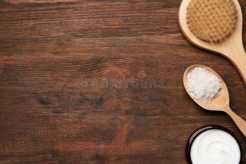 Flat lay composition with body care products and space for text. On wooden background royalty free stock images