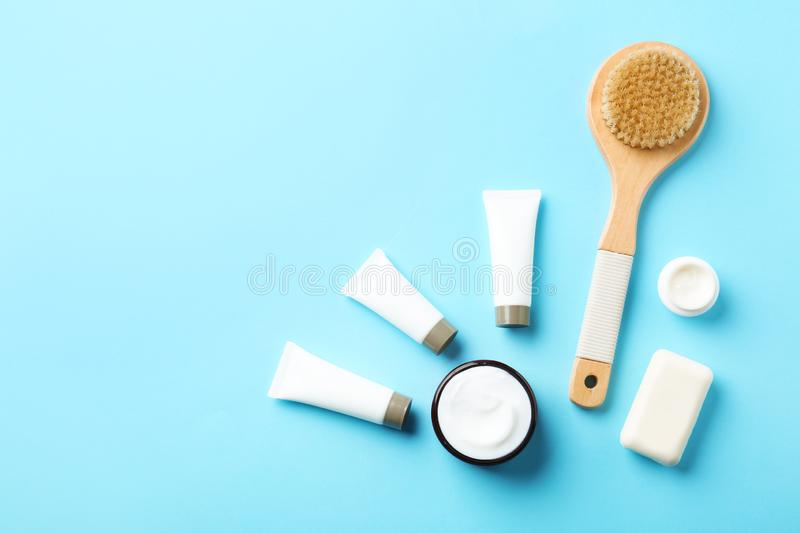 Flat lay composition with body care products and space for text. On color background stock photo