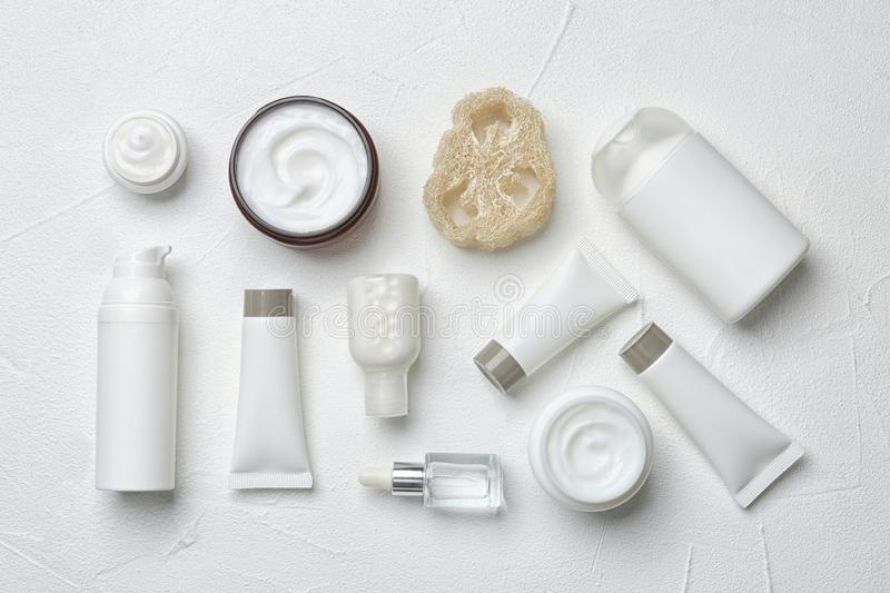 Flat lay composition with body care products on white. Background stock images