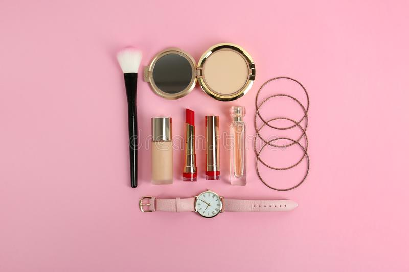 Flat lay composition with bright lipstick and accessories on pink. Background royalty free stock image
