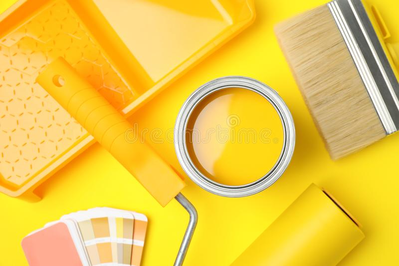 Flat lay composition with can of paint, brush and renovation tools stock images