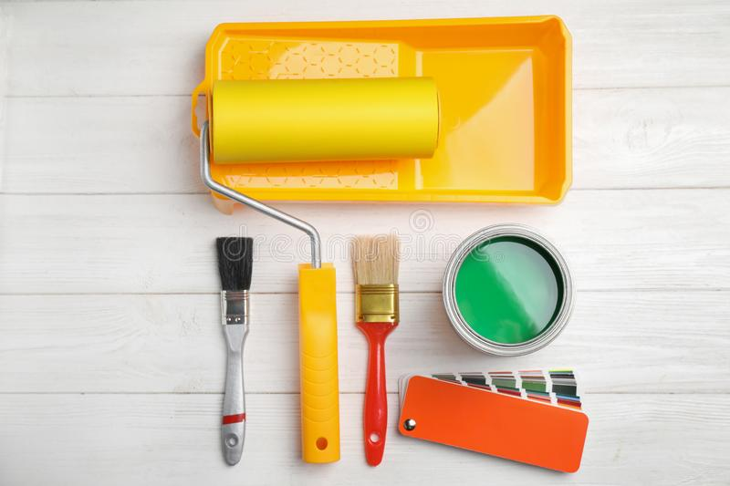 Flat lay composition with can of paint, brushes and renovation tools stock photo