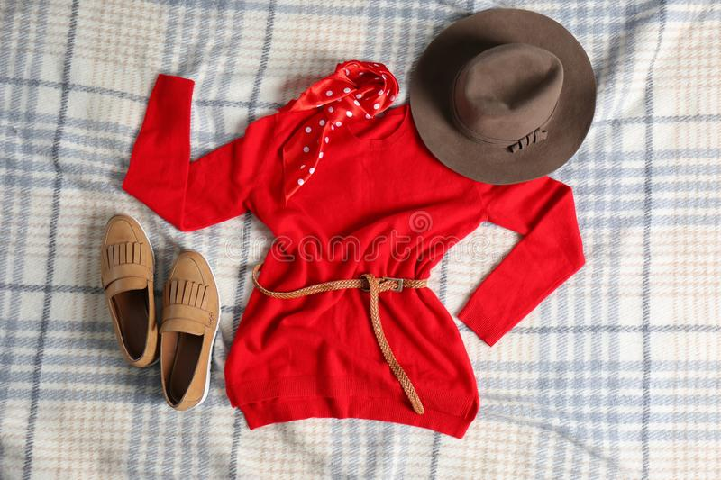 Flat lay composition with cashmere sweater and hat royalty free stock images