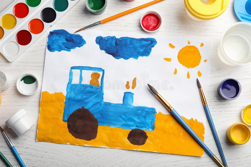 Flat lay composition with child`s painting of tractor on wooden table stock photography
