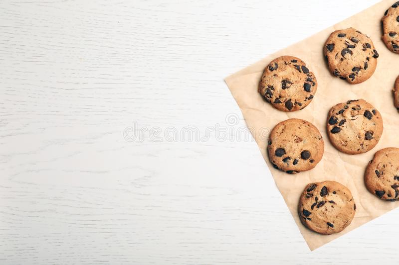 Flat lay composition with chocolate cookies and space for text royalty free stock image