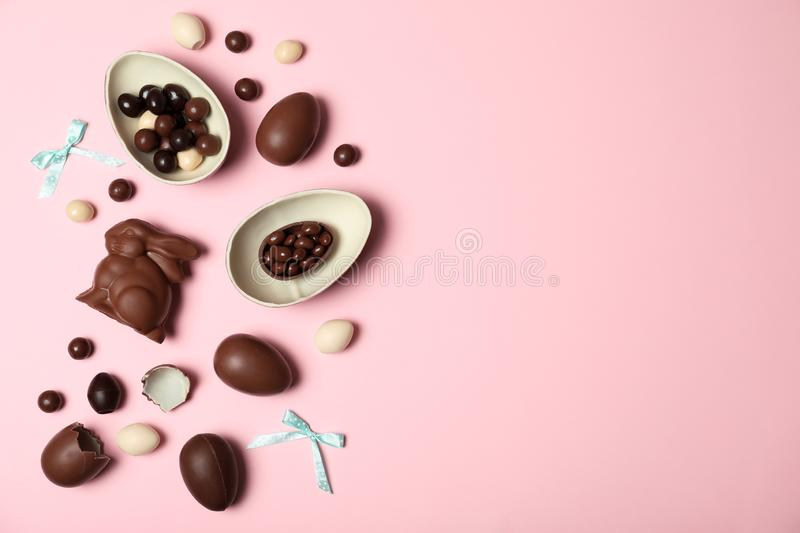 Flat lay composition with chocolate Easter eggs. And space for text on color background royalty free stock images