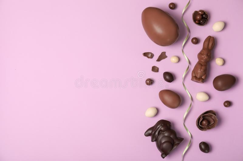 Flat lay composition with chocolate Easter eggs and space for text stock photos