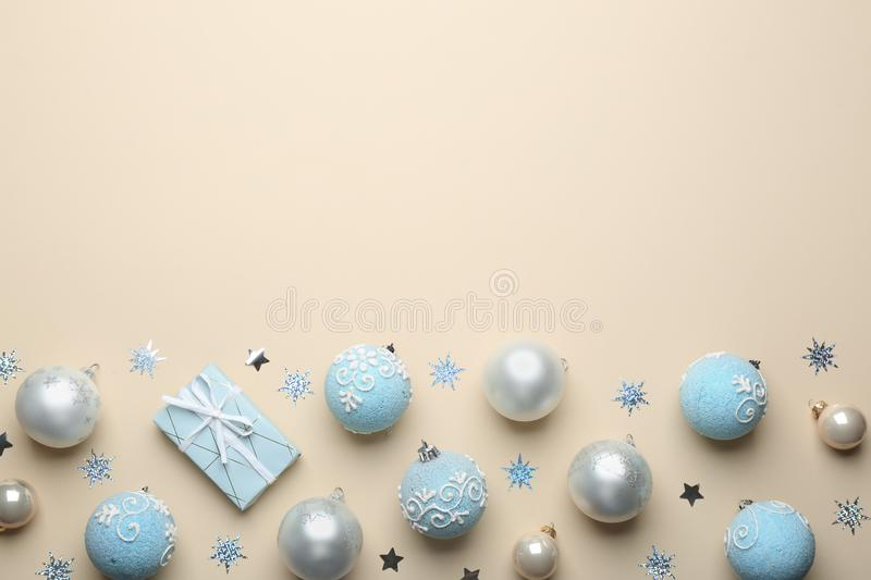 Flat lay composition with Christmas  on beige background, space for text. Winter season. Flat lay composition with Christmas decorations on beige background royalty free stock image