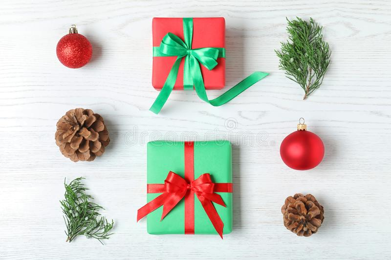 Flat lay composition with Christmas gift boxes on wooden background. Flat lay composition with Christmas gift boxes on white wooden background stock images